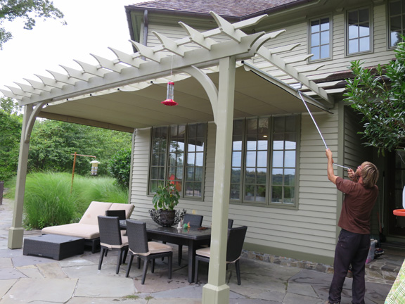 Post and beam pergola with an easy shade